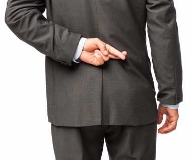 Businessman Crossing Fingers Behind His Back Isolated